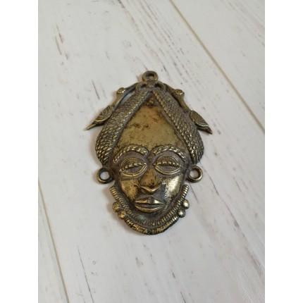 Masque africain en laiton